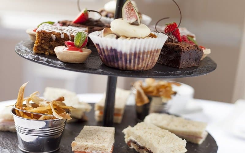 Full Afternoon Tea with sandwiches, warm scones and tempting cakes
