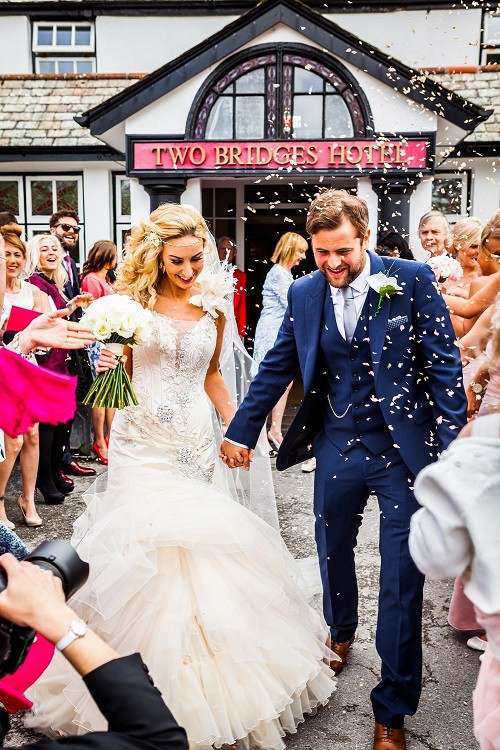 Bride and groom with confetti at Two Bridges Hotel wedding