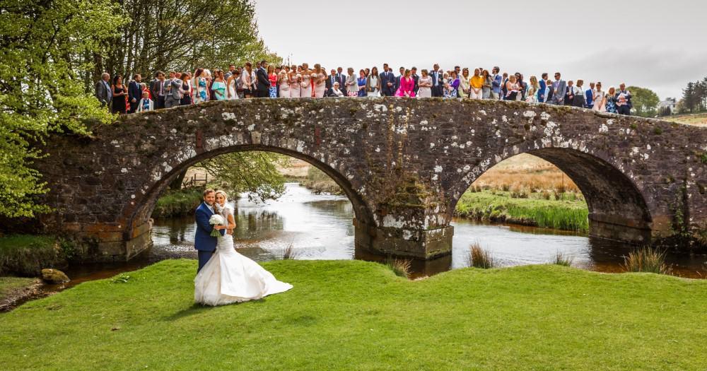 Wedding party on the bridge at Two Bridges Hotel, Dartmoor
