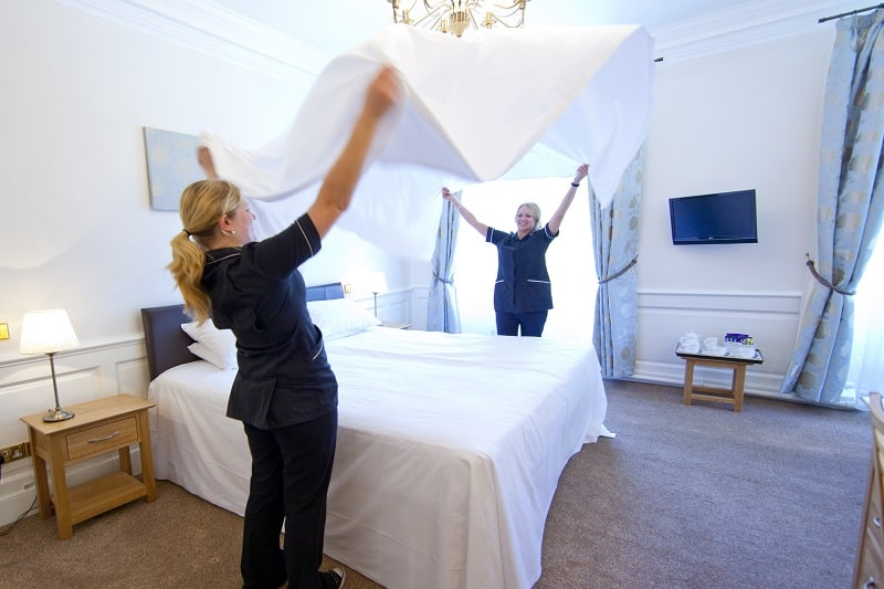 Housekeepers making beds