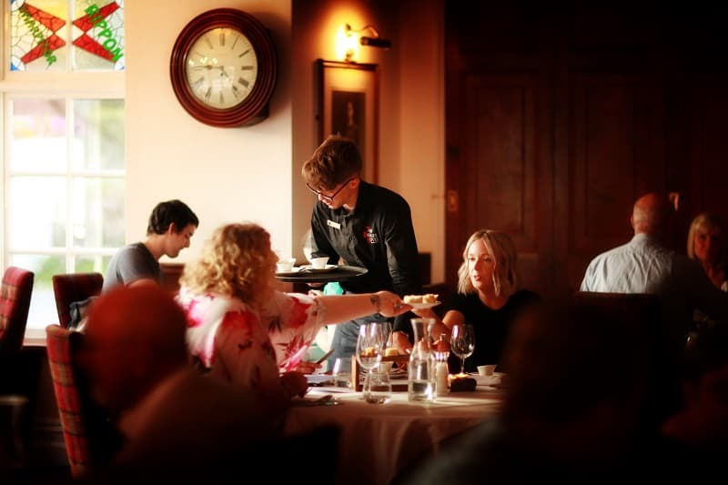 Waiter serving in restaurant